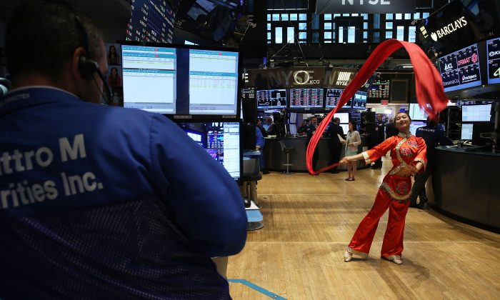 A Chinese dancer at the New York Stock Exchange (NYSE) on July 27, 2015. (Spencer Platt/Getty Images)
