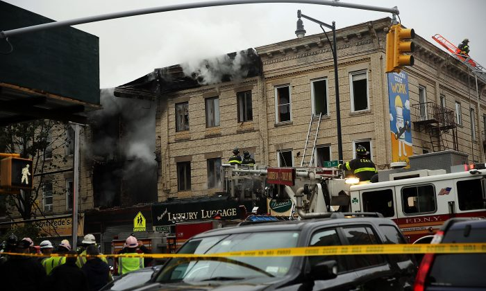 A gas explosion occurred in Borough Park neighborhood on October 3, 2015 in the Brooklyn borough of New York City. Over 100 firefighters responded to the afternoon explosion and fire in the densely populated neighborhood. Two people were killed. (Spencer Platt/Getty Images)