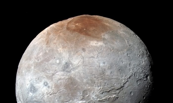 Charon has a huge fracture system, unlike anything seen on Pluto.(NASA/JHUAPL/SwRI)