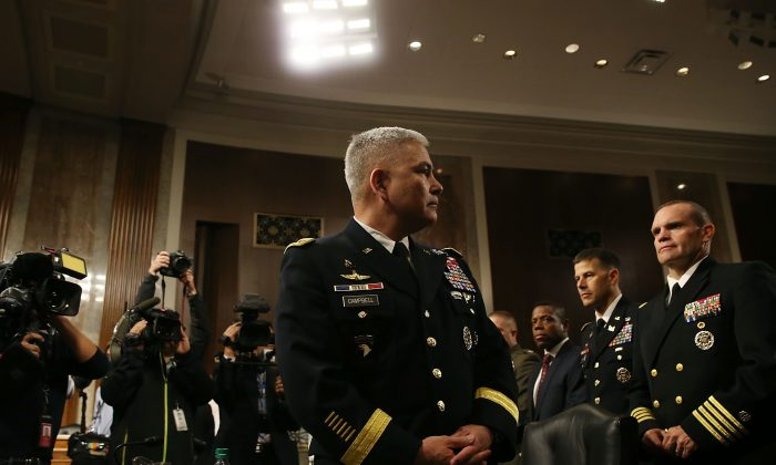 US Army Gen. John Campbell commander of the Resolute Support Mission and United States Force Afghanistan, prepares to testify  during a Senate Armed Services Committee hearing on Capitol Hill September 6, 2015 in Washington, DC. (Mark Wilson/Getty Images)