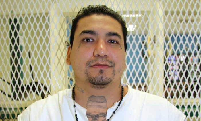 Death row inmate Juan Garcia is photographed in a visiting cage Wednesday, Sept. 2, 2015, at the Texas Department of Criminal Justice Polunsky Unit near Livingston, Texas. (AP Photo/Mike Graczyk)
