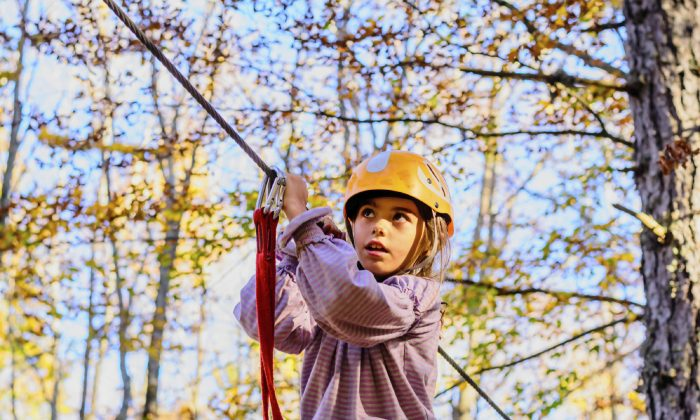 In a new study examining ziplining injuries, nearly half of the cases involved children under 10 years old. (valram/iStock)