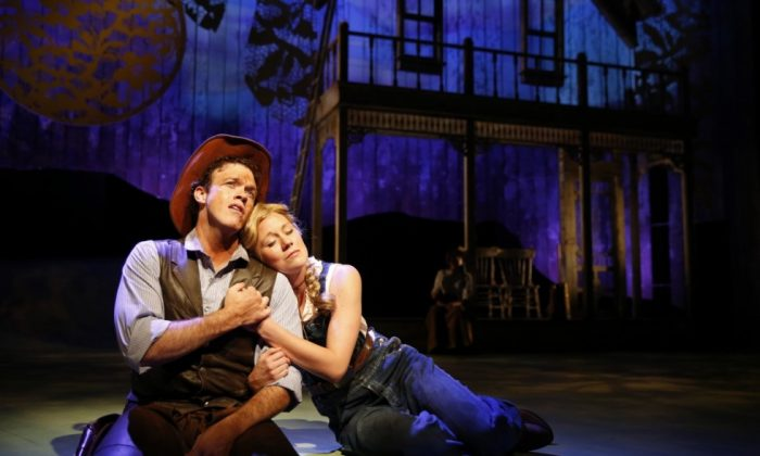 """(L–R) Colte Julian plays Curly and Allison Sill appears as Laurey in Paramount Theatre's production of """"Oklahoma!"""" (Liz Lauren)"""