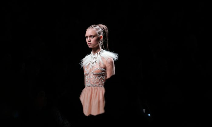 A model wears a creation for Valentino's Spring-Summer 2016 ready-to-wear fashion collection, presented during the Paris Fashion Week, on Oct. 6, 2015 in Paris, France.  (AP Photo/Thibault Camus)