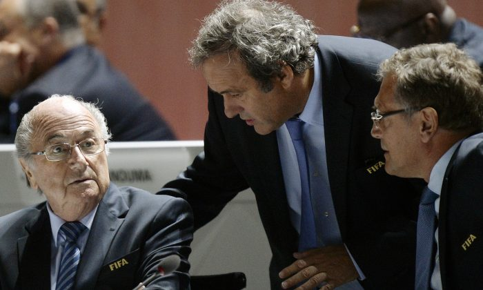 FILE - In this May 29, 2015 file photo FIFA President Sepp Blatter, left, UEFA President Michel Platini, center, and FIFA Secretary General Jerome Valcke, right, are engaged in conversation during the 65th FIFA Congress held at the Hallenstadion in Zurich, Switzerland. On Thursday, Oct. 8, 2015 file photo FIFA provisionally banned President Sepp Blatter, UEFA President Michel Platini and the former secretary general Valcke for 90 days. (Walter Bieri/Keystone via AP)