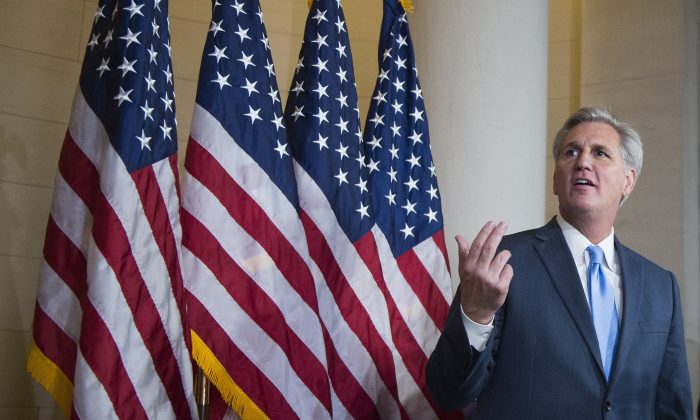 House Majority Leader Kevin McCarthy (R-Calif.) speaks to the press after walking out of the speaker nominee election after dropping out of the race on Capitol Hill in Washington, D.C., on Oct. 8, 2015. (Jim Watson/AFP/Getty Images)