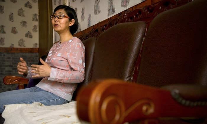 Chinese lawyer Wang Yu speaks during an interview in Beijing. China's state media on July 14, 2015. (AP Photo/Mark Schiefelbein)