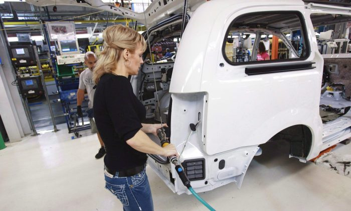 A worker on the production line at Chrysler's assembly plant in Windsor, Ont., on Jan. 18, 2011. The auto sector was one of the key sectors involved in the negotiations for the Trans-Pacific Partnership. (The Canadian Press/Geoff Robins)