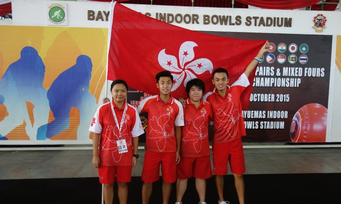 A young squad carrying the Hong Kong flag at the Asia Pacific Merdeka Championship 2015 in Kuala Lumpur, Malaysia. Team members (from left) Olivia Yu, Arthur Lam, Vivian Yip and Adrian Yau returned home empty-handed but shown a strong fighting spirit during the course of the tournament. (Alex Ng)