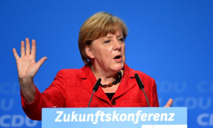 """German Chancellor Angela Merkel addresses the """"Future-conference"""" event of the Christian Democratic Union (CDU) party in Wuppertal, western Germany, on Oct. 8, 2015. (Patrik Stollarz/AFP/Getty Images)"""