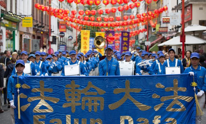 A marching band led the parade through London's Chinatown (Max Lin)