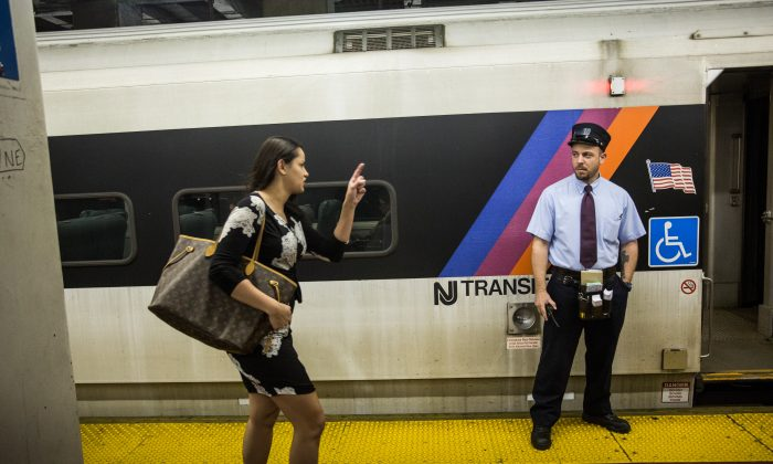 A woman rushes to catch the NJ Transit train from New York Penn Station to Trenton, NJ on May 13, 2015 in New York City. (Andrew Burton/Getty Images)