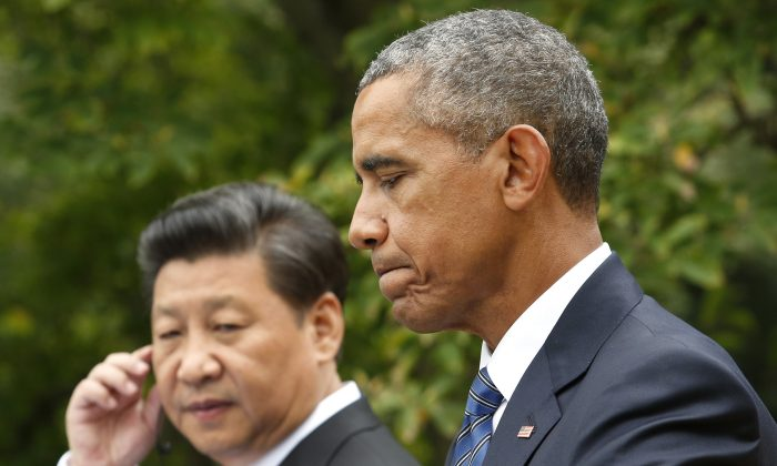 US President Barack Obama speaks next to Chinese President Xi Jinping at a joint press conference after their meeting at the White House in Washington,DC on September 25, 2015.      (YURI GRIPAS/AFP/Getty Images)