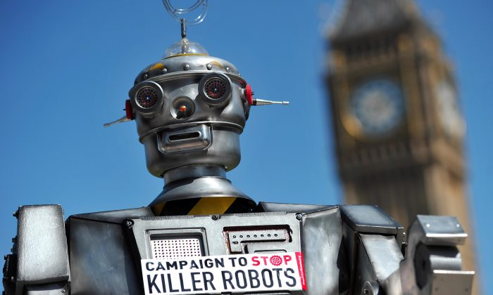 """A mock """"killer robot"""" is pictured in central London on April 23, 2013, during the launching of the Campaign to Stop Killer Robots, which calls for the ban of lethal robot weapons that would be able to select and attack targets without any human intervention. The campaign calls for a pre-emptive and comprehensive ban on the development, production, and use of fully autonomous weapons. (Carl Court/AFP/Getty Images)"""