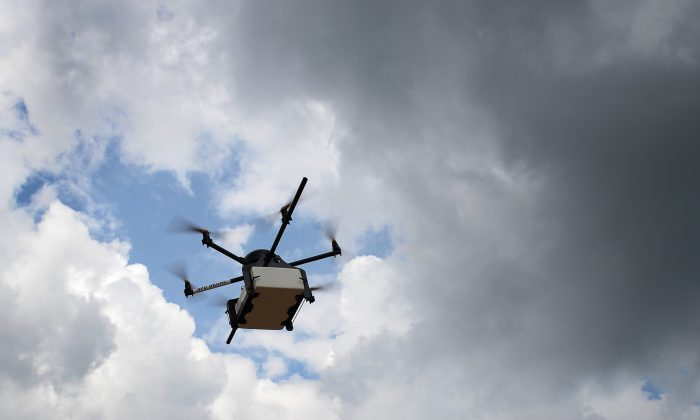 Geopost drone flying in Pourrieres, southeastern France, during a presentation of a prototype of a package delivery drone, on This picture taken on September 28, 2015.  (BORIS HORVAT/AFP/Getty Images)