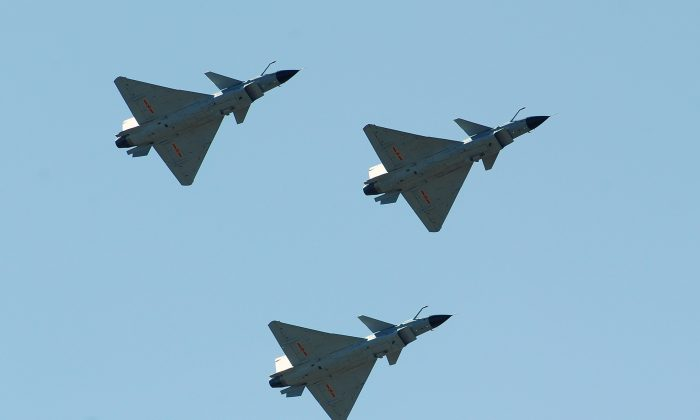 Chinese J-10 fighter jets fly on display over the Yangcun Air Force base of the People's Liberation Army Air Force in Tianjin, China, on April 13, 2010. (Frederic J. Brown/AFP/Getty Images)