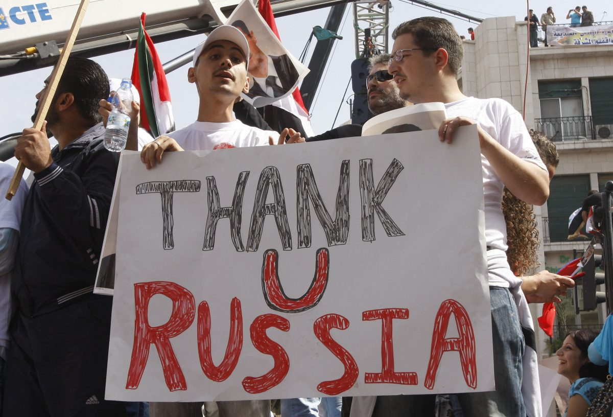 Supporters of the Syrian government hold a pro-Russian banner, during a demonstration in Damascus, Syria, on Oct. 12, 2011, as they show their support for Syrian President Bashar Assad and to thank Russia and China for blocking a U.N. Security Council resolution condemning Syria for its brutal crackdown. (AP Photo/Muzaffar Salman)