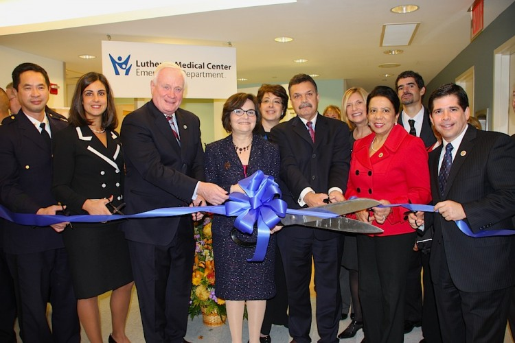 Lutheran Medical Center executive and medical staff, board of trustees, elected officials, and community leaders joined together for a ribbon cutting ceremony in celebration of the expansion of the expanded Emergency Department on Nov. 30. (Hannah Cai/The Epoch Times)