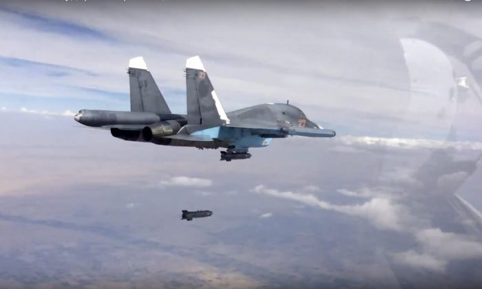 In this file photo made from the footage taken from Russian Defense Ministry official website on Friday, Oct. 9, 2015, a bomb is released from Russian Su-34 strike fighter in Syria. (Russian Defense Ministry Press Service via AP)