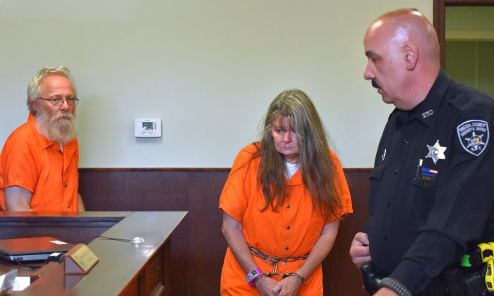 Bruce Leornard, left, and Deborah Leonard, center, enter the courtroom of before their arraignment, Tuesday, Oct. 13, 2015 in New Hartford, N.Y. The central New York couple have been charged with fatally beating their 19-year-old son inside a church, and four fellow church members have been charged with assault in an attack that also left the young man's brother severely injured, police said Tuesday.  (Mark DiOrio/Observer-Dispatch via AP)  ROME OUT; MANDATORY CREDIT