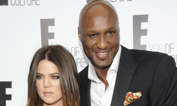 """Khloe Kardashian Odom and Lamar Odom from the show """"Keeping Up With The Kardashians"""" attend an E! Network upfront event at Gotham Hall in New York on April 30, 2012. (AP Photo/Evan Agostini)"""