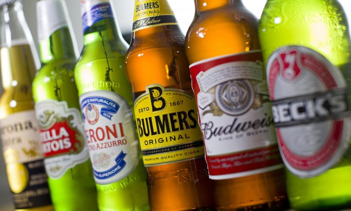 Bottles of beer and cider produced by Belgian-Brazilian group Anheuser-Busch InBev, (Budweiser, Corona, Stella, and Beck's) and British brewer SABMiller. (Justin Tallis/AFP/Getty Images)