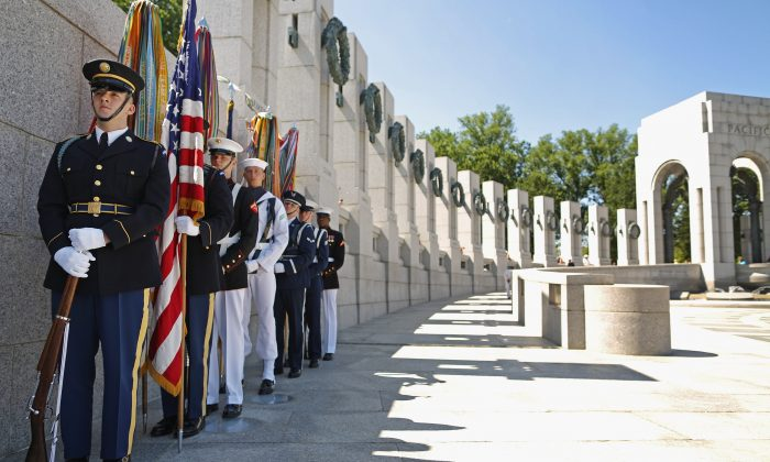 An honor guard prepares to participate in the 70th anniversary D-Day commemoration at the WWII Memorial on the National Mall June 6, 2014 in Washington, DC. On Oct. 10, Orange County veterans took an honor flight to D.C. to visit the memorial.  (Chip Somodevilla/Getty Images)