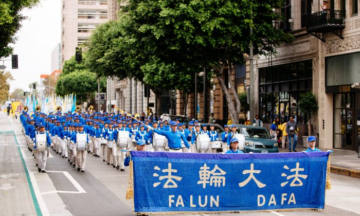 The Divine Land Marching Band performs during a parade calling for an end to the persecution of Falun Gong in China, in Los Angeles on Oct. 15, 2015. (Edward Dye/Epoch Times)