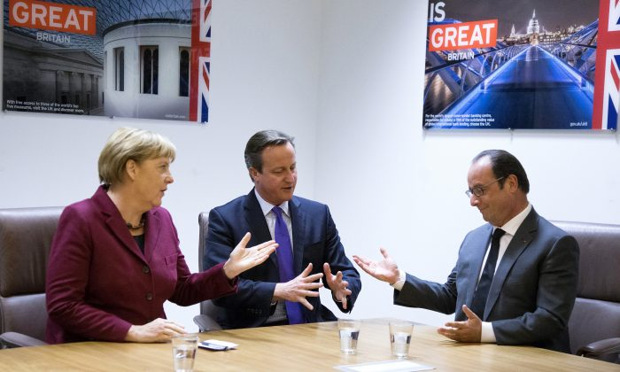 German Chancellor Angela Merkel, left, speaks with British Prime Minister David Cameron, center, and French President Francois Hollande as they meet on the sidelines of an EU summit in Brussels on Thursday, Oct. 15, 2015. (Yves Herman, Pool Photo via AP)