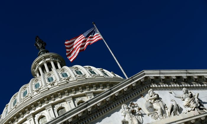 An American flag waves outside the U.S. Capitol building in Washington, D.C., on Sept. 29, 2013. (Win McNamee/Getty Images)