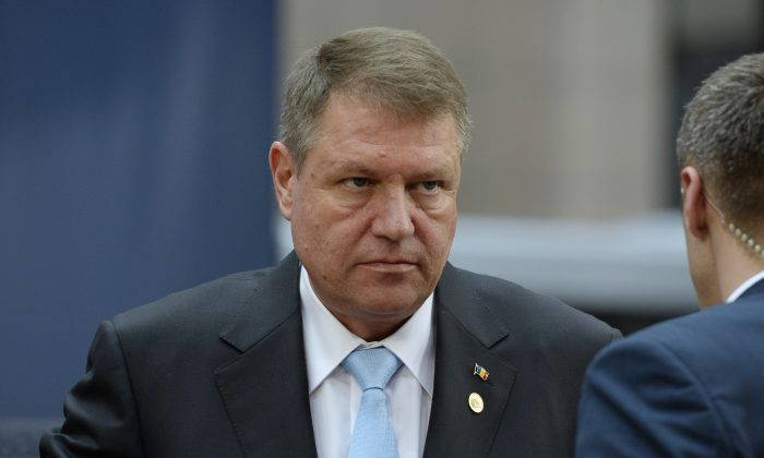 Romanian President Klaus Werner Iohannis arrives at a European Union (EU) summit in Brussels on Oct. 15, 2015. (Thierry Charlier/AFP/Getty Images)