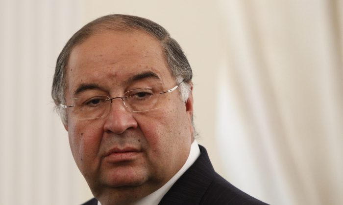 Uzbek-born Russian businessman Alisher Usmanov attends a meeting between Russian President Vladimir Putin and Crown Prince of Abu Dhabi Sheikh Abdullah bin Zayed al-Nahayan during their meeting at the Novo-Ogaryovo state residence outside Moscow September 12, 2013.  (Maxim Shemetov/AFP/Getty Images)