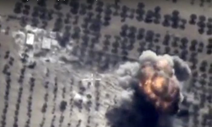 A target hit during Russian air raid in Syria, on Friday, Oct. 16, 2015  (AP Photo/ Russian Defense Ministry Press Service)