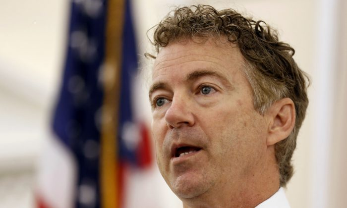 In this Oct. 9, 2015, file photo, Republican presidential candidate Sen. Rand Paul, R-Ky. speaks during a campaign stop at the Republican Liberty Caucus in Nashua, N.H.  (AP Photo/Jim Cole)