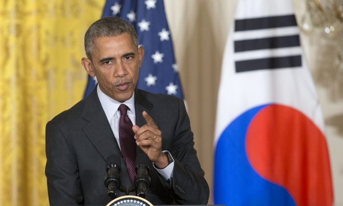 President Barack Obama gestures while answering questions during a joint news conference with South Korean President Park Geun-hye in the East Room of the White House in Washington, D.C., on Oct. 16, 2015. (AP Photo/Pablo Martinez Monsivais)