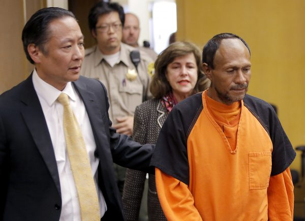 Juan Francisco Lopez-Sanchez (R) is lead into the courtroom by San Francisco Public Defender Jeff Adachi (L) and Assistant District Attorney Diana Garciaor (C), for his arraignment at the Hall of Justice in San Francisco. Juan, an illegal immigrant with seven felony convictions in the U.S. and previously deported to Mexico five times, fatally shot 32-year-old Kate Steinle on July 1. (Michael Macor/San Francisco Chronicle via AP)