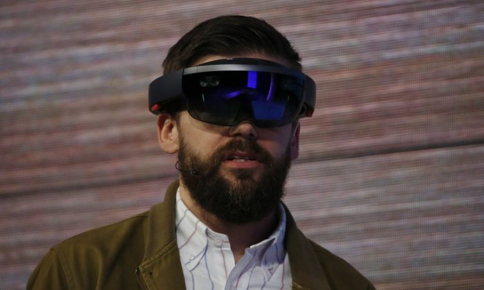 The Microsoft HoloLens augmented reality headset is demonstrated on stage during the 2015 Microsoft Build Conference at Moscone Center in San Francisco, Calif., on April 29, 2015. (Stephen Lam/Getty Images)