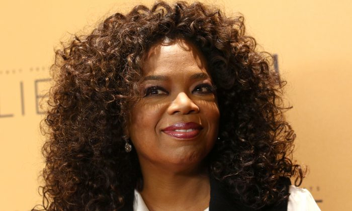 "In this Wednesday, Oct. 14, 2015, file photo, Oprah Winfrey attends the premiere of the Oprah Winfrey Network's (OWN) documentary series ""Belief,"" at The TimesCenter in New York. Weight Watchers announced Monday, Oct. 19, 2015, that Winfrey is taking an approximately 10 percent stake in Weight Watchers for about $43.2 million and joining the weight management company's board. (Photo by Greg Allen/Invision/AP, File)"