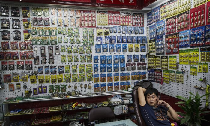 A Chinese trader waits for customers at his stall selling wholesale locks at the Yiwu International Trade City on September 25, 2015 in Yiwu, China. (Kevin Frayer/Getty Images)