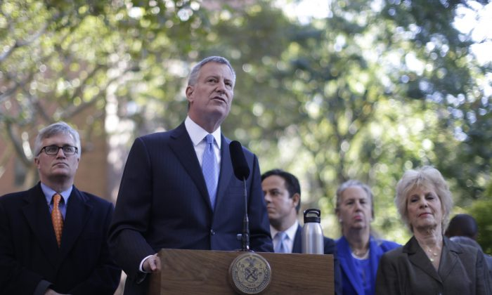 New York City Mayor Bill de Blasio speaks during a news conference at the Stuyvesant Town complex, Tuesday, Oct. 20, 2015, in New York.  Manhattan's largest apartment complex will be sold for $5.3 billion in a deal that will preserve nearly half its 11,232 units for middle-class families, New York City officials said Tuesday. (AP Photo/Mary Altaffer)