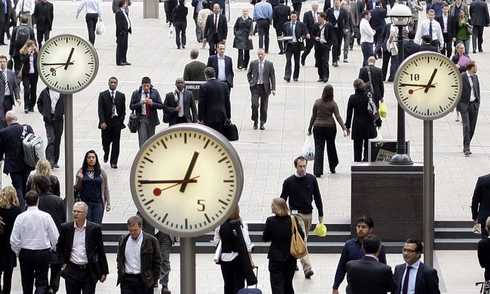 City workers walk through London's Canary Wharf on Sept. 16, 2008. (Shaun Curry/AFP/Getty Images)