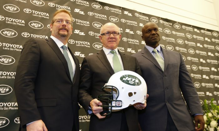 New York Jets Owner Woody Johnson (C) hired new head coach Todd Bowles (R) and GM Mike Maccagnan to team the team around and it's worked thus far. (Rich Schultz /Getty Images)