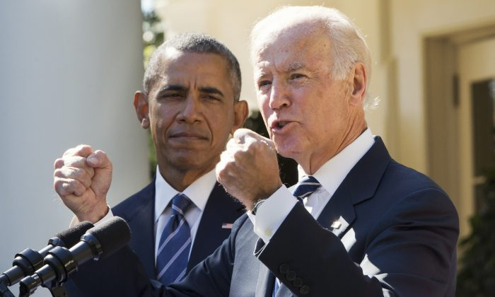 Vice President Joe Biden, with President Barack Obama, gestures as he speaks in the Rose Garden of the White House in Washington, on Oct. 21, 2015, to announce that he will not run for the presidential nomination. (Jacquelyn Martin/AP Photo)