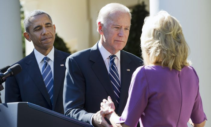 President Barack Obama watches as Vice President Joe Biden turns to his wife Dr. Jill Biden after announcing that he will not run for the presidential nomination,  in Washington, on Wednesday, Oct. 21, 2015. (AP Photo/Jacquelyn Martin)