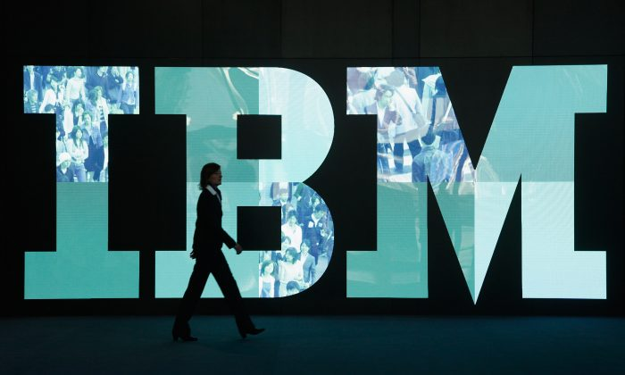 A woman walks past the IBM logo at the CeBIT technology trade fair in Hanover, Germany, on Feb. 28, 2011. (Sean Gallup/Getty Images)