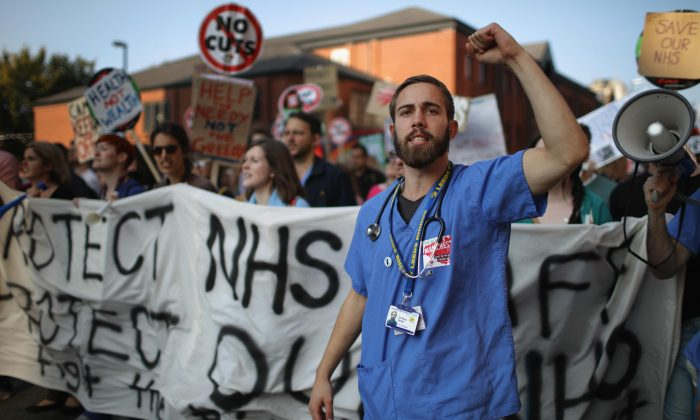 NHS workers take part in an anti-austerity protest in Manchester, England, on Oct. 4, 2015. (Christopher Furlong/Getty Images)