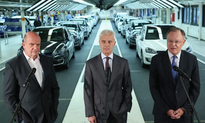 New Volkswagen Group Chairman Matthias Mueller (C), Volkswagen Work Council head Bernd Osterloh (L) and Lower Saxony Governor Stephan Weil hold a press conference at the assembly line of the Volkswagen factory on Oct. 21 in Wolfsburg, Germany. It was recently exposed that Volkswagen vehicles had software to dupe smog tests. (Photo by Sean Gallup/Getty Images)