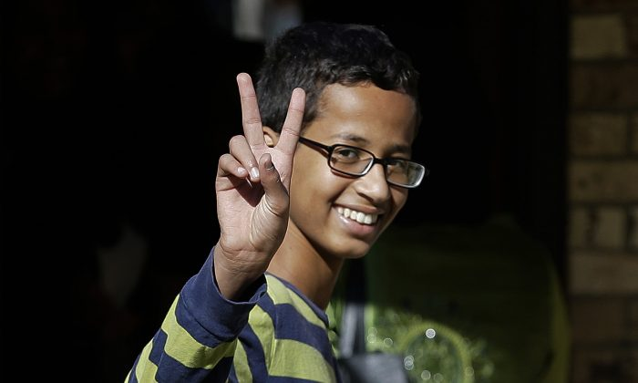In this Sept. 17, 2015, file photo, Ahmed Mohamed gestures as he arrives to his family's home in Irving, Texas. (AP Photo/LM Otero)