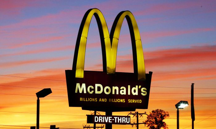 The sun sets behind a McDonald's restaurant in Ebensburg, Pa., on Oct. 10, 2015. (AP Photo/Gene J. Puskar)