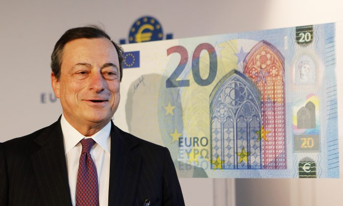 Mario Draghi, the president of the European Central Bank, stands next to a copy of a 20 euro banknote in Frankfurt, Germany, Feb. 24, 2015  (AP Photo/Michael Probst)